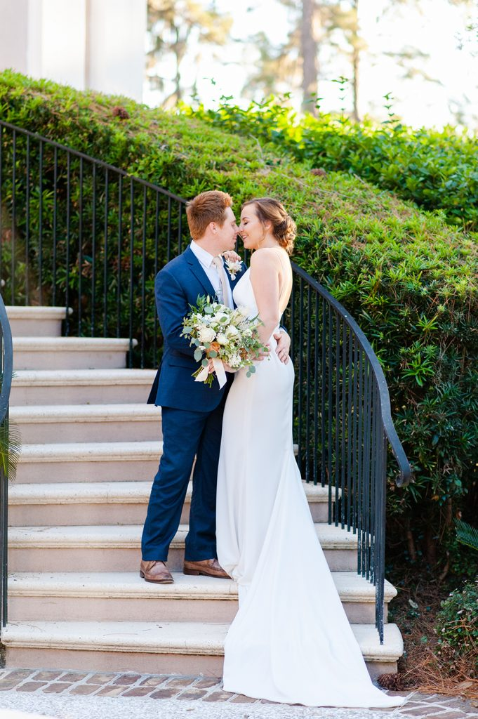 bride and groom on the steps of Oldfield River Club