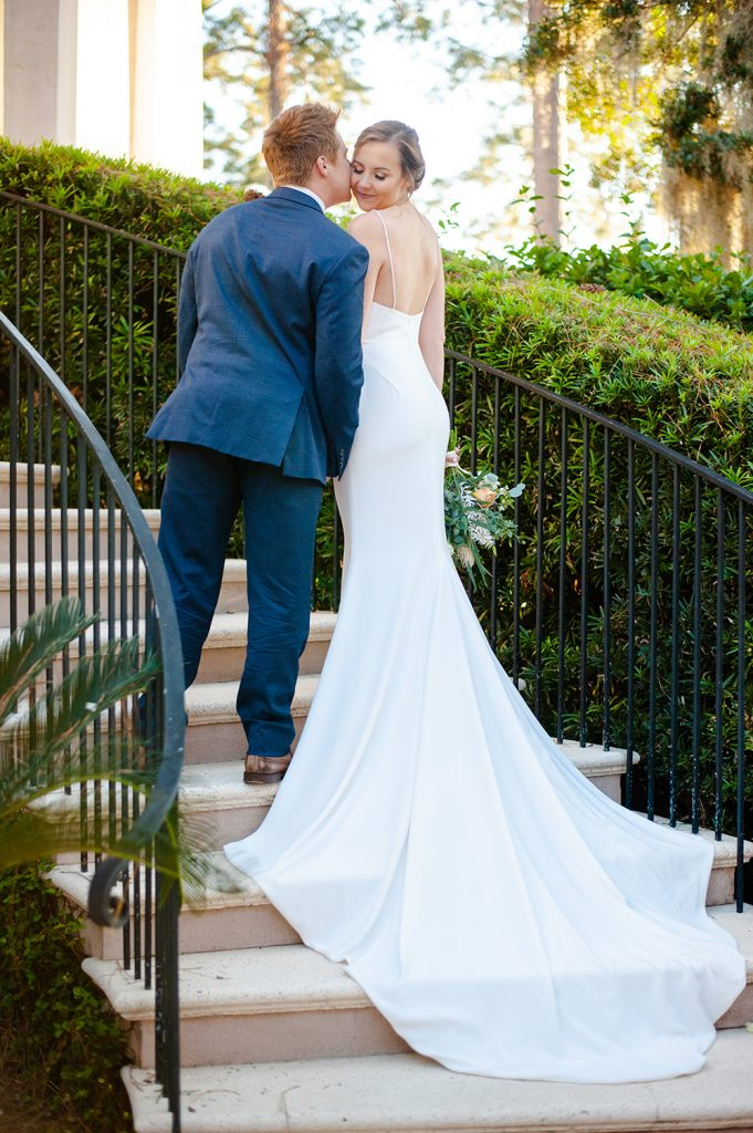 bride and groom on the steps of Oldfield River Club in SC