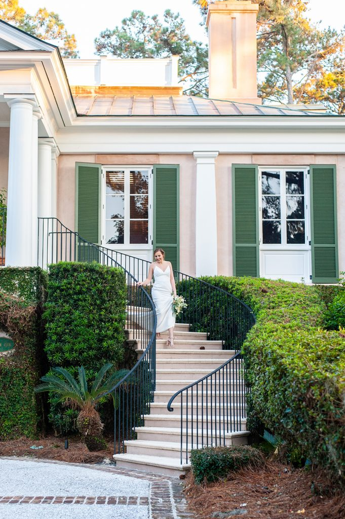 bride walking down staircase at Oldfield River Club