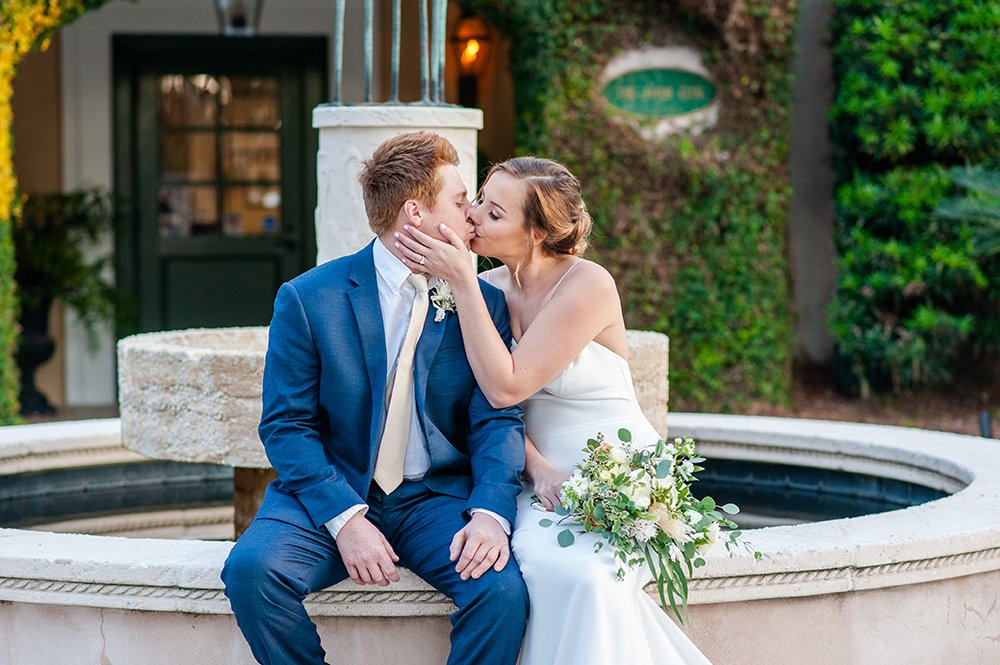 kiss by the Oldfield Club fountain