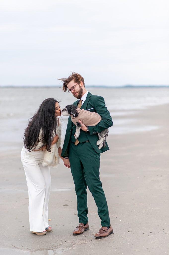bride kisses dog on Folly Beach