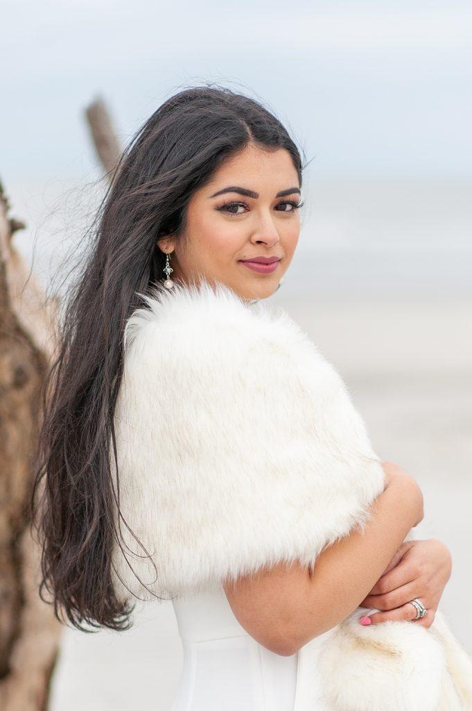 bride in white fur stole on Folly Beach