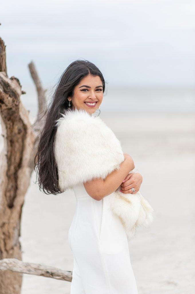 bride in white fur stole on Folly Beach in Charleston, SC