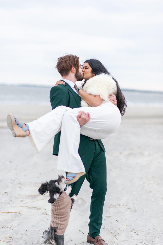groom picks up bride on Folly Beach