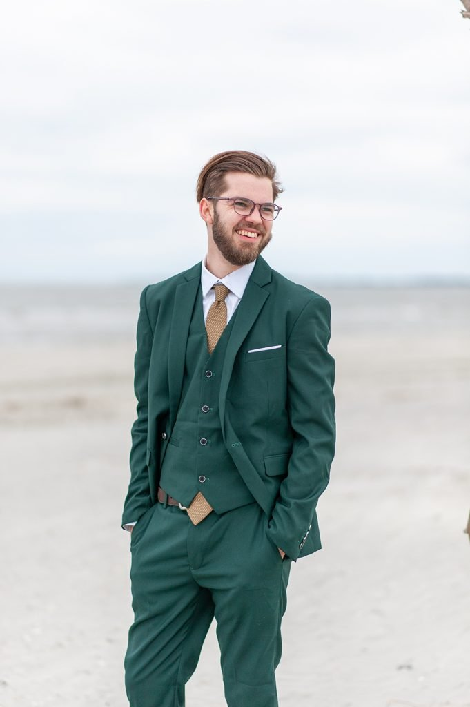 groom in green suit on Folly Beach