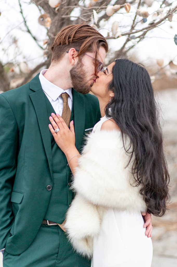 bride and groom kiss at Folly Beach elopement