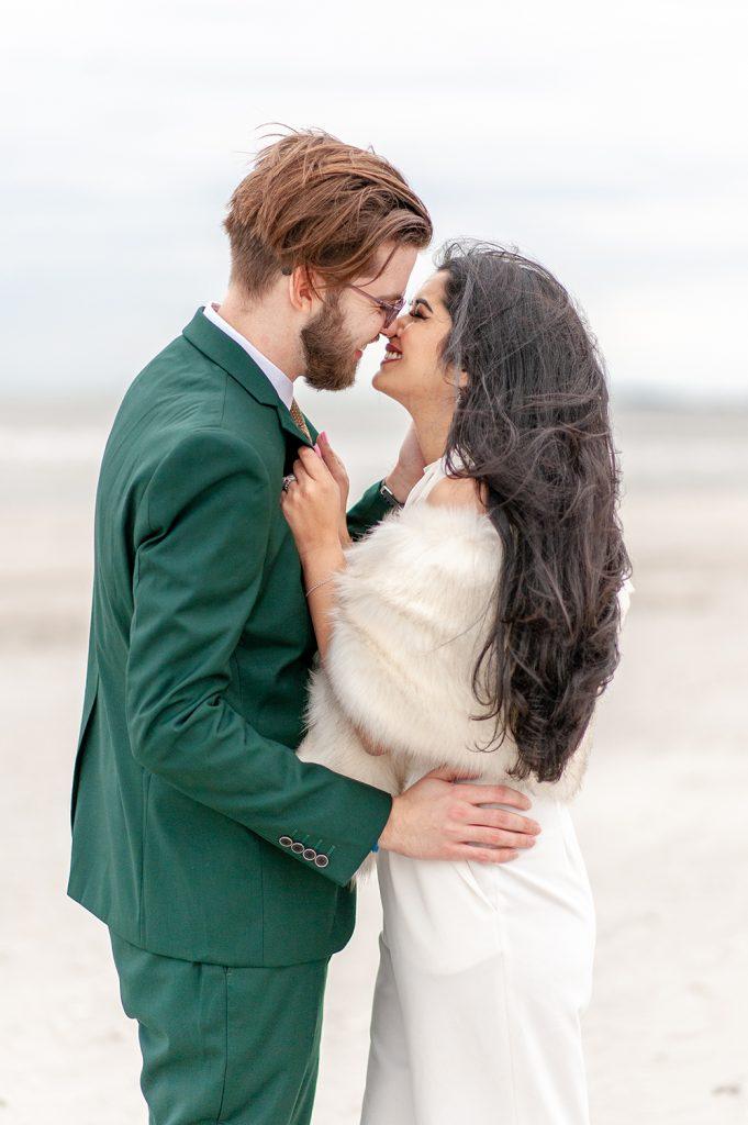 bride and groom kiss on Folly Beach in Charleston, SC