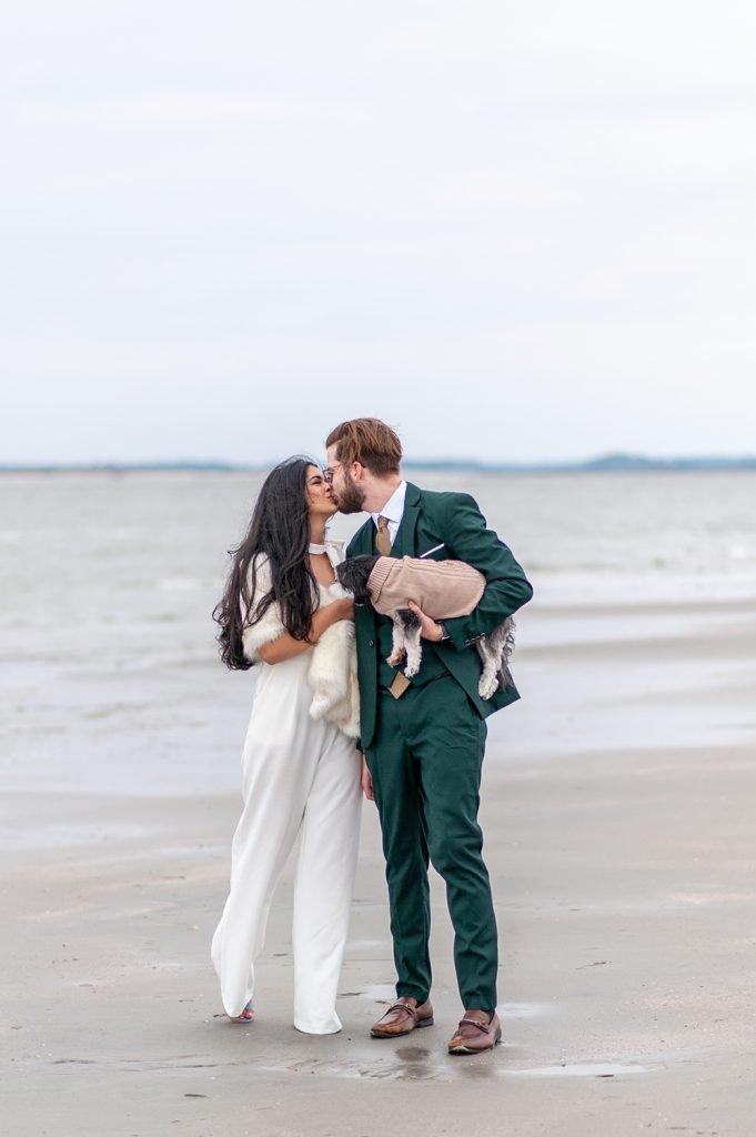bride and groom kiss on Folly Beach