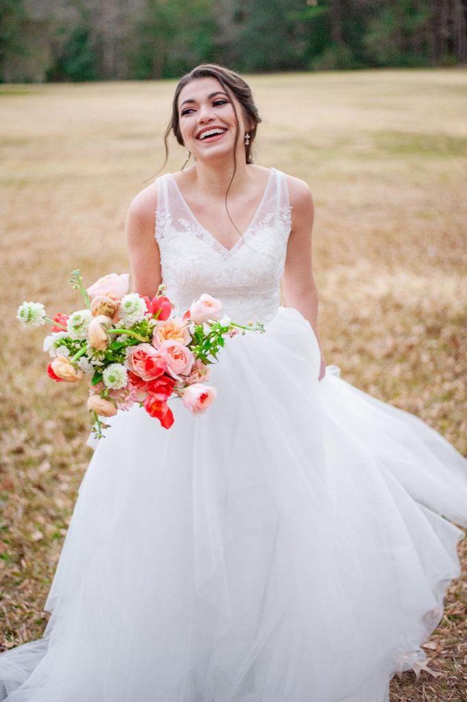 laughing bridal photo at Runnymede Plantation with colorful bouquet in Charleston, SC