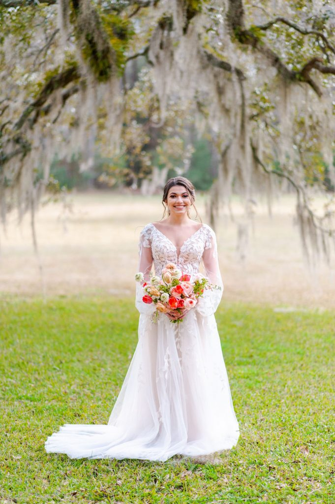 bridal portrait at Runnymede Plantation in Charleston, SC with Spanish moss and big oak tree