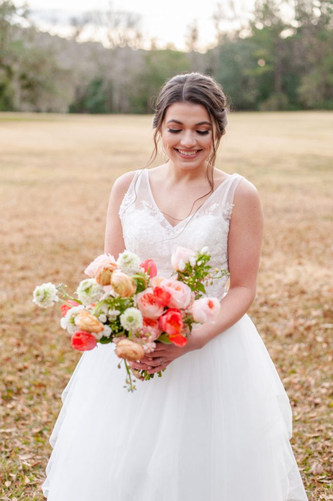 Bridal portrait at Runnymede Plantation in Charleston, SC with colorful wedding bouquet
