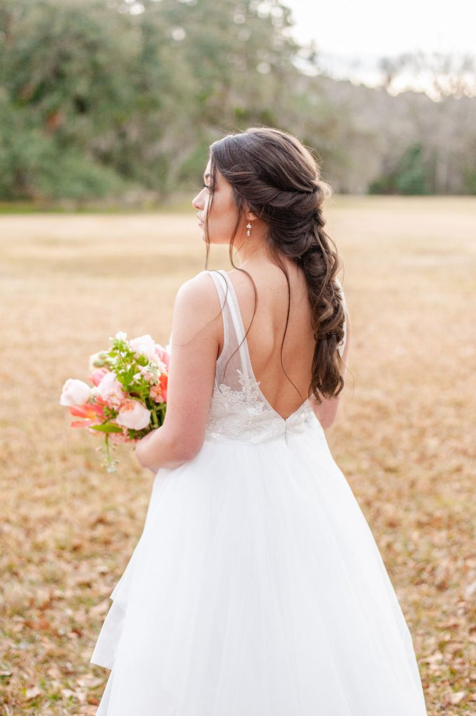 Bridal photos at Runnymede Plantation in Charleston, SC with colorful bridal bouquet