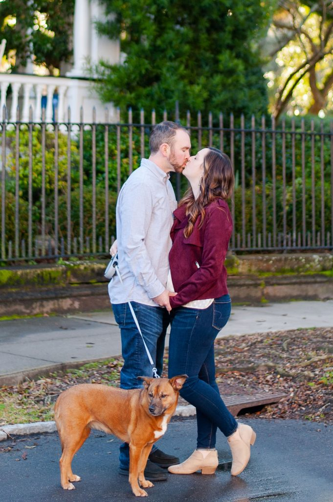 Downtown Charleston couples photos with dog on Meeting Street