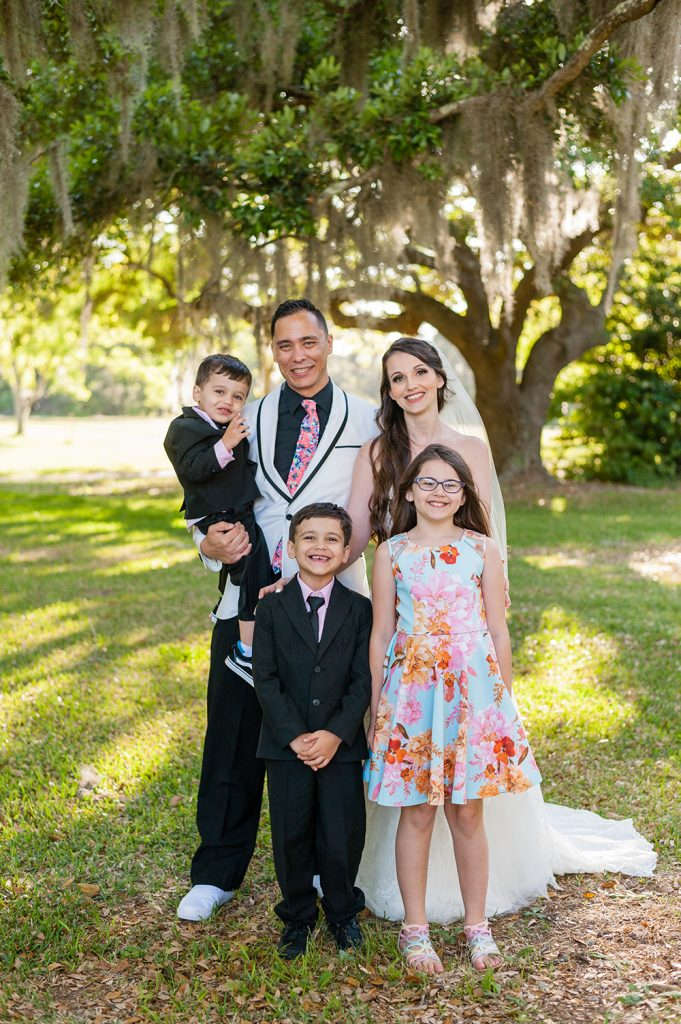 bride and groom portrait with kids at A Whitehouse Wedding in Charleston, SC