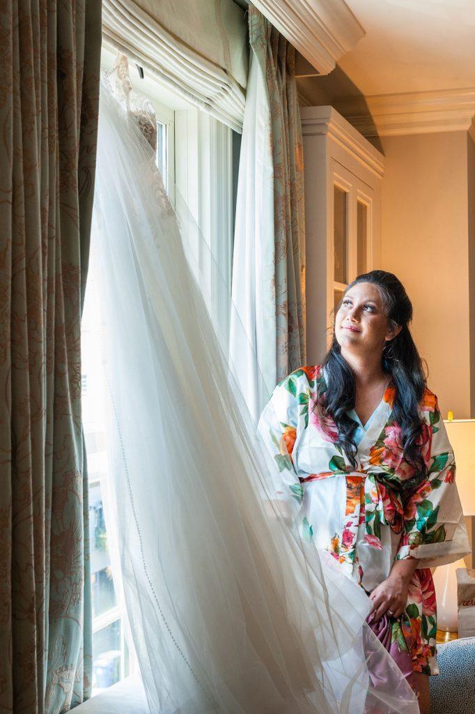 Bride admiring her wedding dress at Hotel Bennett in Charleston, SC