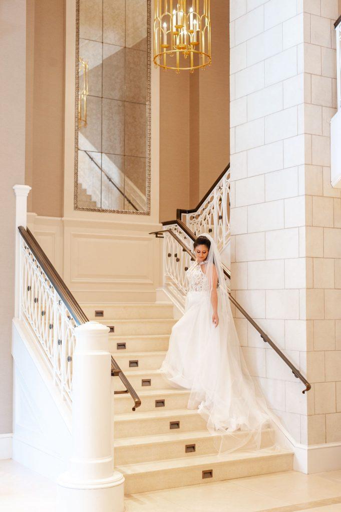 Bridal portrait on staircase at Hotel Bennett in Charleston, SC