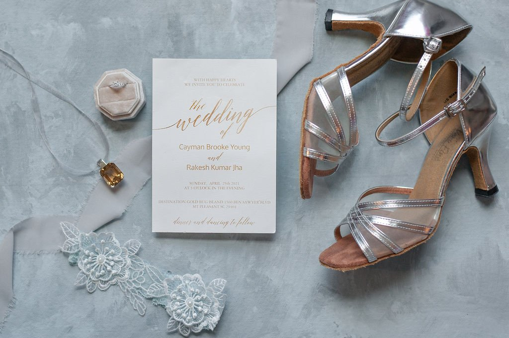Bridal details flatlay in silver, grey, and gold