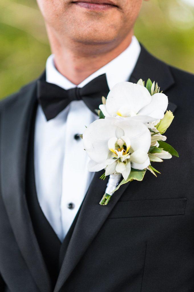 Groom in black tux at Goldbug Island, Destination Gold Bug wedding venue in Charleston, SC