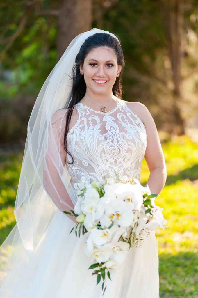 Bridal portrait with white orchid bouquet at Wedding at Goldbug Island, Destination Gold Bug wedding venue in Charleston, SC
