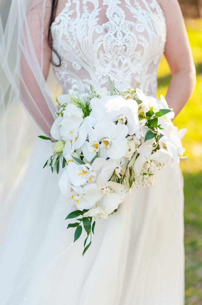 white orchid bouquet - Wedding at Goldbug Island, Destination Gold Bug wedding venue in Charleston, SC
