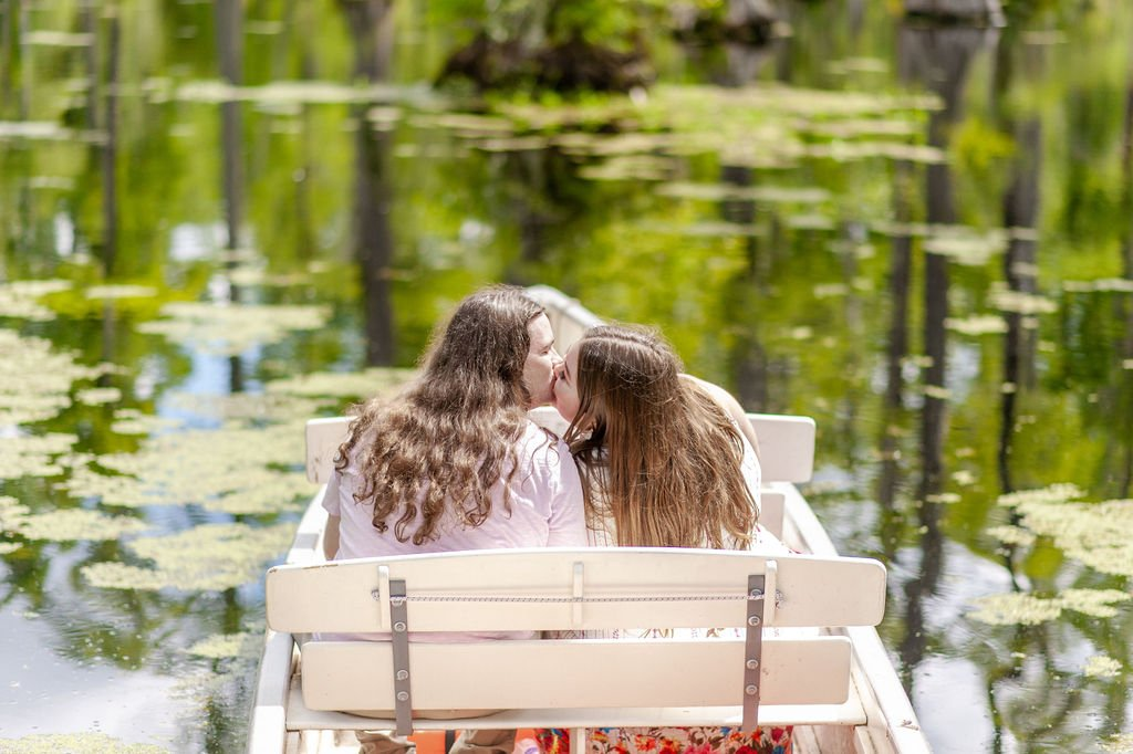 The Notebook inspired Cypress Gardens engagement photos with couple in row boat