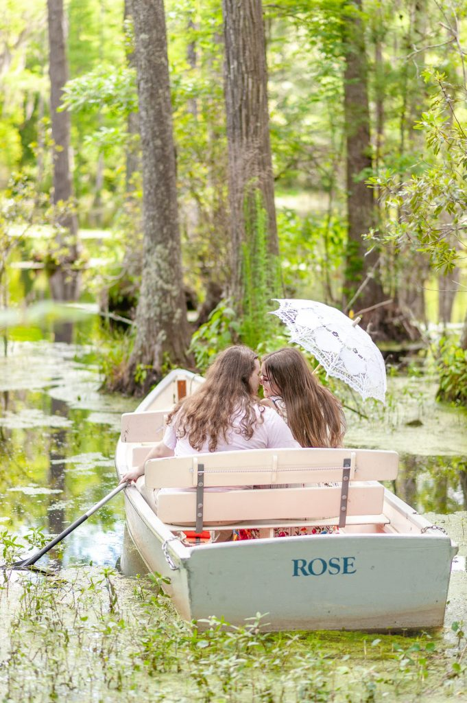 The Notebook style engagement photos at Cypress Gardens in row boats
