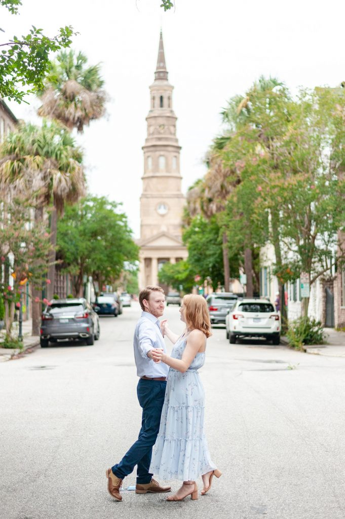 Downtown Charleston engagement photos in front of St. Philip's Church