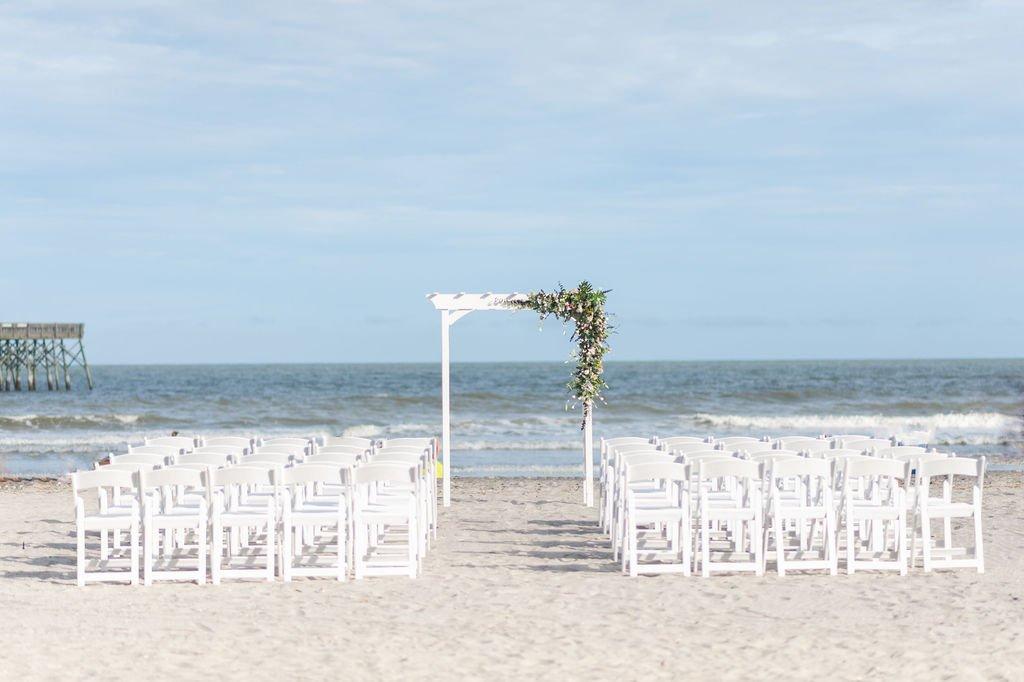 Folly Beach pier wedding ceremony setup