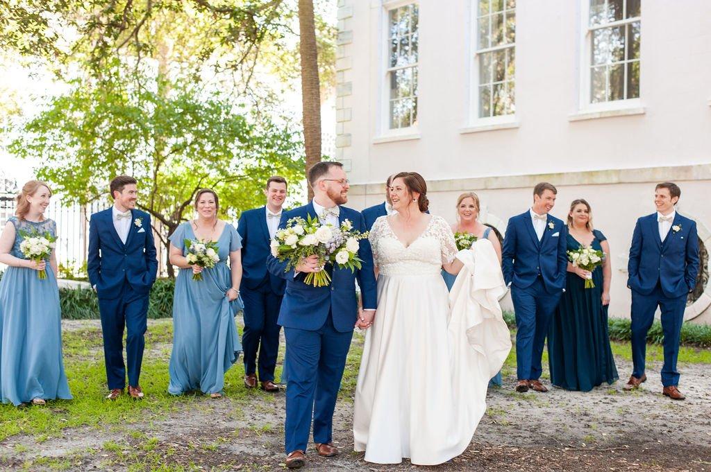 Wedding party in blue at Washington Square in Charleston, SC before South Carolina Aquarium wedding
