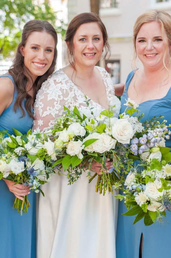 Bride and bridesmaids with white flowers