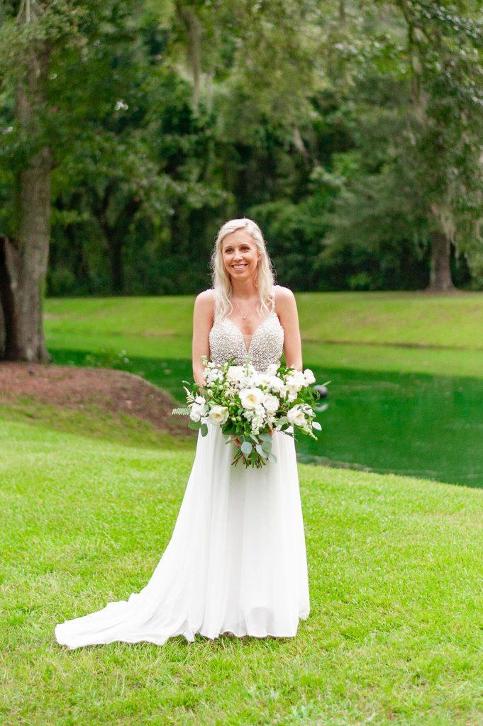bridal portrait beside pond at Dogwood Downs