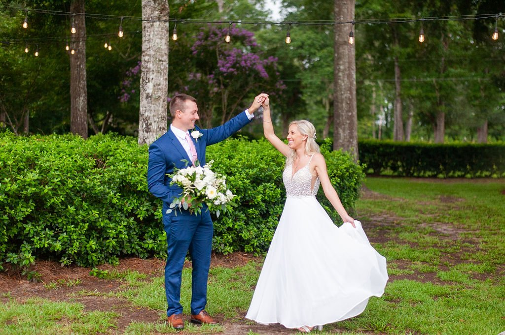 bride and groom twirling at Dogwood Downs wedding