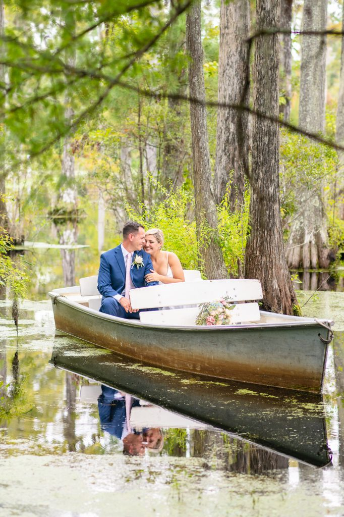 Bride and groom in rowboat at Cypress Gardens